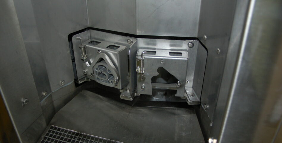 Fixture of a carousel parts washer