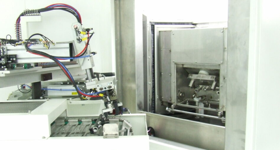 Fixture robot for carousel parts washer