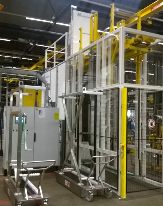 Parts cleaning machine with automatic loader